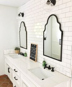 These white sinks with brushed bronze faucets
