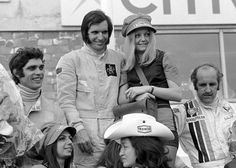 Francois Cevert and Denny Hulme on the podium with race winner Emerson Fittipaldi at the Belgian Grand Prix 1972 (Nivelles)
