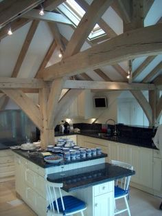 Like the way this kitchen fits around the oak frame, by Roderick James Architects