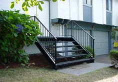 This railing looks really nice and functional. My grandparents have stairs that go outside that need to have railings installed. It seems like a nice rod iron railing would look nice but also be sturdy enough to help them safely get down the stairs. Front Porch Railings, Balcony Railing, Rod Iron Railing, North Vancouver, Go Outside, Grandparents, Really Cool Stuff, How To Look Better, Stairs