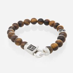 Juggling life's daily puzzle requires a strong mind and confidence. This piece is a handmade executive bracelet made with Brown Tiger Eye stones to naturally exude strength, confidence and integrity.  It's the perfect portrayal of a Nordic lifestyle infused with the Balinese mindset. Its wearers are able to juggle life's challenges with confidence while prioritizing important moments.