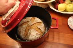 Artisanal Homemade sourdough bread baked in iron cast casserole.  Step4