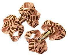Pink animal print grosgrain ribbon bows on alligator clips  #girlsbows #pinkbows #hairclips #hairslides #fashionbows #ukbows