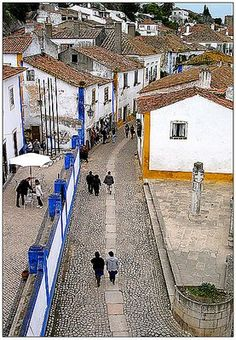obidos portugal. The bed and breakfast Laurie and I stayed at is on this street.  We had to park outside the city and walk in since her car would not fit down these streets.