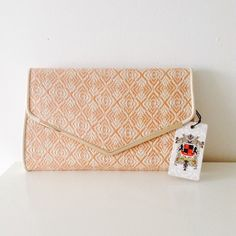 "Gorgeous Woven Vegan Clutch/ Shoulder Purse This is a summer clutch like no other. Gorgeous woven detailing in a rustic and cream color. Has a shoulder strap that can be also worn Crossbody. Gold hardware with button closure, step not adjustable. So perfect and versatile, will definitely add that extra bam to any outfit. Measures 12"" L  7"" H 2.5"" W Urban Expressions Bags"