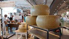 Parmesan cheeses at Eataly in Rome.