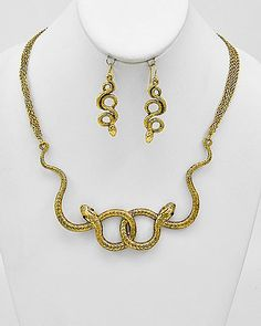 Temptress Gold Snake Statement Necklace, $14.00  Find fun fabulous fashion jewellery and statement jewlry at Strike Envy. #jewellery #jewlry StrikeEnvy.com