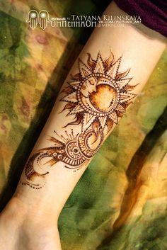Mehndy by Tatyana Kilinskaya I Love the sun & moon piece!!!