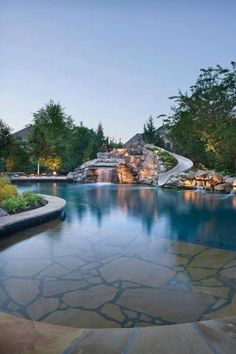 The natural boulder waterfall of this lagoon-style pool definitely attracts attention. The pool also features a spacious grotto, custom fiberglass waterslide, and tanning shelf. Banks Pool & Spa Design, Overland Park, Kansas www. Luxury Swimming Pools, Luxury Pools, Dream Pools, Swimming Pool Designs, Amazing Swimming Pools, Pool Spa, Hotel Pool, Spa Design, House Design