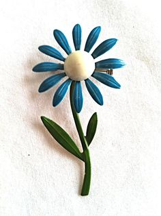 Vintage Enamel Blue Flower Brooch Pin by NonabelleVintage on Etsy I had one of these in pink