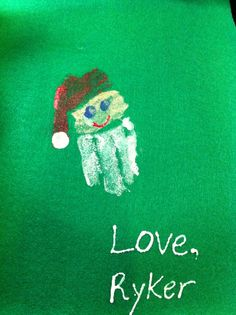Fun craft for children of all ages. Handprint painted into Santa's face. Fingerprints for eyes and end of hat. (I got glued this around a wooden dowel and used a red ribbon for hanging.)