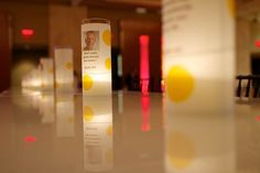 Yellow and white votive candleholders held information about the foundation's work.