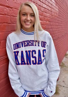Make a sporty statement with this Kansas Jayhawks Champion Mens Grey Reverse Weave Arch Crew Sweatshirt! Rally House has a great selection of new and exclusive Kansas Jayhawks t-shirts, hats, gifts and apparel, in-store and online. Kansas Jayhawks Football, Cheer Outfits, Cheer Clothes, Kentucky Basketball, Duke Basketball, Kentucky Wildcats, College Basketball, Basketball Players, Crew Sweatshirts