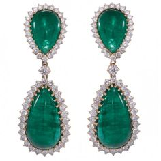 Emerald and diamond earrings by Yvel