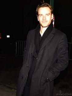 Dressed in Black, longer hair, ginger stubble.....
