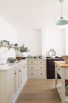 A simple run of base cupboards keeps this space feeling light, airy and uncomplicated