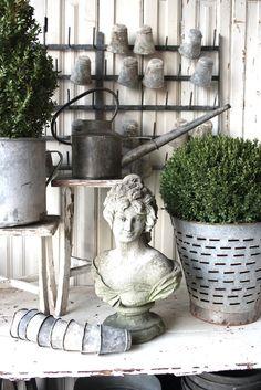zinc display ... watering cans ... pots ... planters