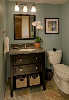 Half bathroom ideas and they're perfect for guests. They don't have to be as functional as the family bathrooms, so hope you enjoy these ideas. Update your bathroom decor quickly with these budget-friendly, charming half bathroom ideas Downstairs Bathroom, Bathroom Renos, Bathroom Renovations, Home Remodeling, Master Bathroom, Bathroom Makeovers, Office Bathroom, Bathroom Vanities, Bathroom Storage