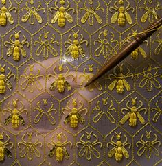 """Constellation of 69 bees, the symbol of the Empire and the emblem of the Guerlain family of """"Eaux"""". Sylvie Deschamps, Maître d'art, handcrafts """"The Festive Attire"""", """"L'Habit de Fête"""", a covering designed as an imperial coronation robe."""
