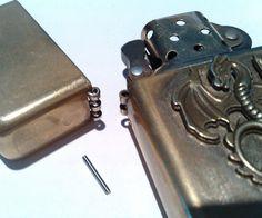 Titan hinge pin for petrol lighters