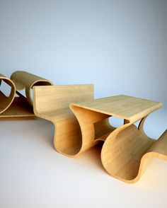 Two benches facing away from each other, or a picnic table with built-in seating when flipped upside down. Designed by Tomasz Chmielewski