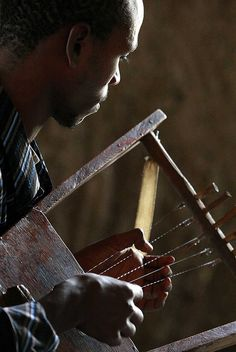 A young man playing the k'ra, a traditional instrument of Ethiopia
