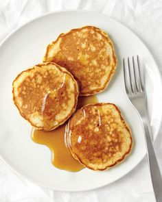 Quinoa Cakes - Martha Stewart Recipes: INGREDIENTS: 1 cup cooked quinoa or brown rice, 3/4 cup all-purpose flour, 2 teaspoons baking powder, 1/2 teaspoon coarse salt, 1 large egg, plus 1 large egg white, 1 tablespoon unsalted butter, melted, plus more for skillet, 1/4 cup low-fat milk, 2 tablespoons pure maple syrup, plus more for serving, Fresh fruit or fruit preserves (optional), for serving