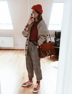 red beanie + beige cardigan + red striped shirt + plaid pants + red vans