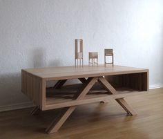 Coffee Table E is a minimalist design created by Germany-based designer Sebastian Erazo Fischer. The table is made in Beech wood with the legs extending past the drawer to not only offer more support but provide aesthetic individuality to the piece as well. (3)