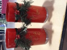 Christmas vases painted and vinyl lettered with dollar store garland and holly berries