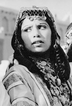 Africa | Woman with face tattoos dressed in festival costume. Atlas Mountains, Morocco. ca. 1959 || Scanned vintage postcard; Publisher G Gillet.