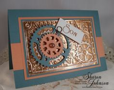 This card created by Sharon Johnson from The Stamp Simply Ribbon Store.  She used Spellbinders embossing foil and Creative Cogs M-Bossibilities; Spellbinders Sprightly Sprockets, Long Classic Rectangles Lg.  All available @ her store. Page 1 of 2
