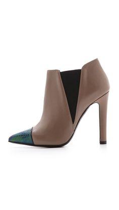 Shop now: Studio Pollini cap toe booties