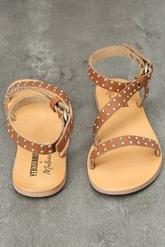 The Amuse Society x Matisse Rock Muse Tan Leather Studded Sandals are the perfect combo of Boho and rocker babe fashion! Rounded, silver studs cover the toe strap, and second matching strap that crosses the vamp and wraps around the ankle. Adjustable snap buttons. Available in whole sizes only.