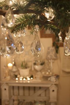 Add Pine Branches and Small Hanging Crystals to a Chandelier for a Romantic Holiday Decoration