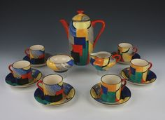 Susie Cooper Handpainted in a rich Cubist pattern coffee set; Comprising coffee pot and lid high, cream jug and sugar basin together with six coffee cans and saucers. With the Grays Pottery twin funnel liner backstamp. Art Nouveau, Susie Cooper, Clarice Cliff, Rookwood Pottery, Tea Pot Set, Coffee Set, Coffee Cans, Art Deco Furniture, Ceramic Painting