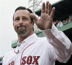 Retired Boston Red Sox pitcher Tim Wakefield waves to fans as he is introduced during a ceremony to honor his career, prior to the Red Sox's baseball game against the Seattle Mariners at Fenway Park in Boston,