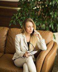Beautiful business woman. Telephone conversation