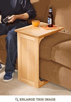 Exactly what ive been looking for! Sofa Server Woodworking Plan - link gives you plan to make it. ($5 for plan)