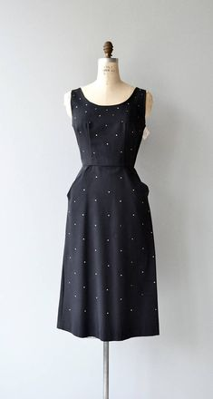 Vintage 1950s black rayon faille cocktail dress with subtle prongset rhinestone, wide neckline, fitted waist, hip pockets and metal back zipper. --- M E A S U R E M E N T S --- fits like: medium bust: 36-38 waist: 28 hip: 38 length: 45 brand/maker: n/a condition: excellent to ensure a