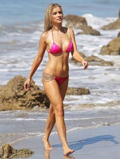 With her slim body and Regular blond hairtype without bra (cup size 32B) on the beach in bikini