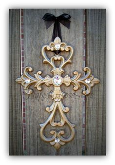 This is a gorgeous, wall-hanging iron cross, shown in CHAMPAGNE, accented with rhinestones! Makes a fabulous decor piece for your home, on your cross