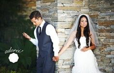 Bride and Groom hold hands around the corner and pray for each other.