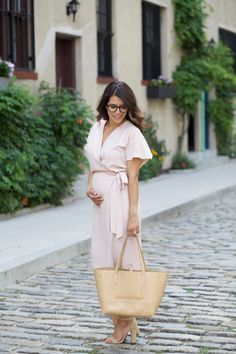 The Corporate Catwalk What to Wear to Work | Pink Wrap Dress - The Corporate Catwalk. Light pink wrapped midi dress+beige ankle strap heeled sandals+beige tote bag. Summer office outfit 2016