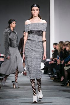 Grey dress, open black stockings, white shoes. A look from the Proenza Schouler Fall 2015 RTW collection.