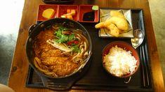 "Miso katsu kimchi udon with pumpkin tempura and other sides. Restaurant named ""Misoya"", circa 2015. Seoul, South Korea"