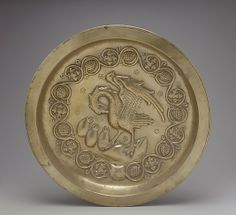 Plate with Pelican in her Piety  Date:     15th century Geography:     Made in Dinant or Malines, Netherlands Culture:     Netherlandish Medium:     Brass Dimensions:     Overall: diam.19 7/8 x 3 in. (diam. 50.5 x 7.6 cm) Classification:     Metalwork