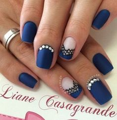 Velvet blue added with diamonds and black pattern is the perfect way to look stunningly regal. And that's just for the nails.