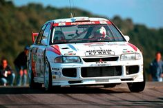 Mid 90′s, Group A Tommi Makinen piloted RALLIART Evolution III.