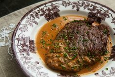 Steak Diane, 1/2 cup beef broth*   4 teaspoons Worcestershire sauce   2 teaspoons Dijon mustard   2 teaspoons tomato paste   4 (6-ounce) center cut beef tenderloin steaks or another cut of your choice   Salt   2 Tbsp butter   1/2 cup finely minced shallots   4 Tbsp cognac or brandy   1/3 cup heavy cream   Freshly ground black pepper   1-2 Tbsp chives, finely chopped